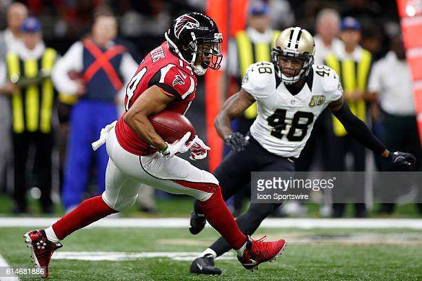 Atlanta Falcons Wide Receiver Eric Weems runs the ball past New Orleans Saints Safety Vonn Bell at the MercedesBenz Superdome in New Orleans LA