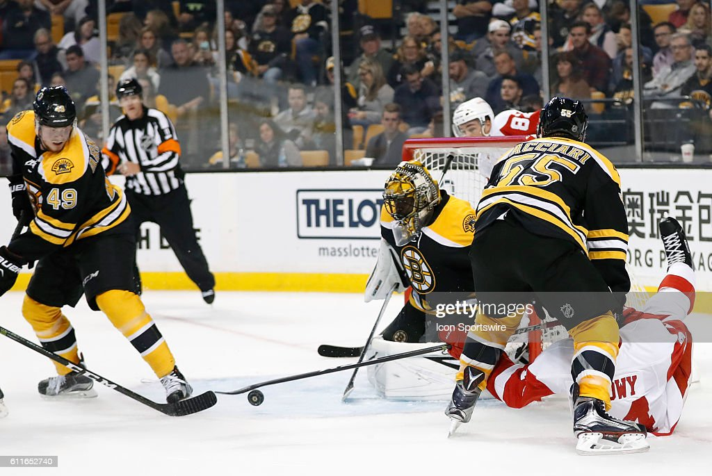 Boston Bruins Goalie Malcolm Subban 7256 Eyes The Loose Puck In