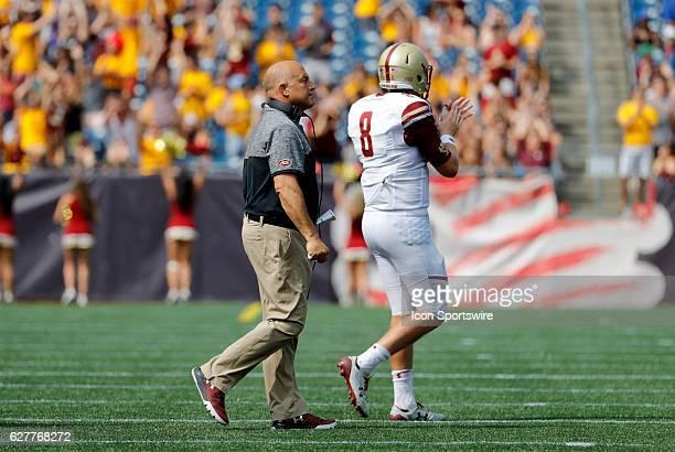 Boston College head coach Steve Addazio chats with Boston College quarterback Patrick Towles The Boston College Eagles defeated the University of...