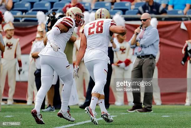 Boston College linebacker Matt Milano celebrates his sack with Boston College defensive lineman Harold Landry The Boston College Eagles defeated the...