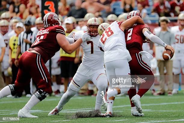 Boston College linebacker Matt Milano wraps up UMass quarterback Ross Comis for a sack The Boston College Eagles defeated the University of...