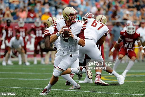 Boston College quarterback Patrick Towles rolls out of the pocket The Boston College Eagles defeated the University of Massachusetts Minutemen 267 at...