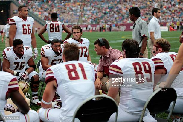 Boston College run game coordinator/offensive line coach Justin Frye speaks with his players The Boston College Eagles defeated the University of...