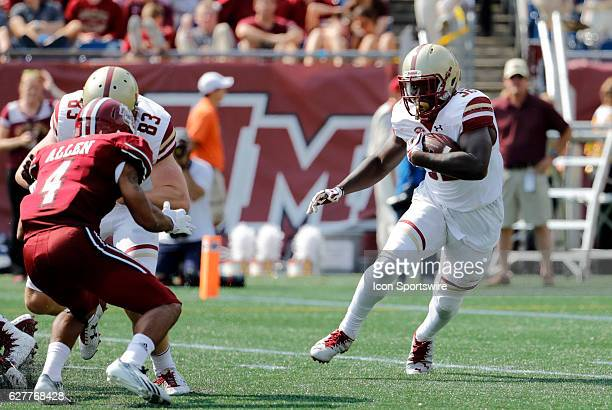 Boston College running back Jon Hilliman looks for a way around UMass cornerback James Allen The Boston College Eagles defeated the University of...