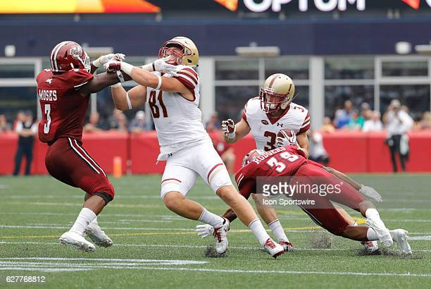 Boston College wide receiver Chris Garrison clocks UMass safety Lee Moses for Boston College wide receiver Michael Walker as UMass cornerback Isaiah...