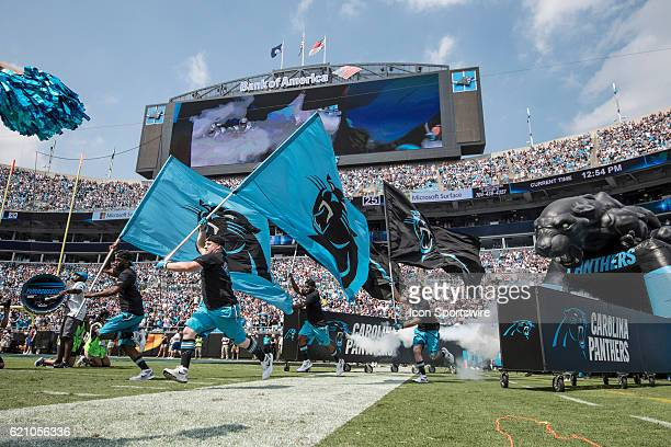 Carolina Panthers players run out with Panthers flags onto the field in game action between the Minnesota Vikings and the Carolina Panthers at Bank...