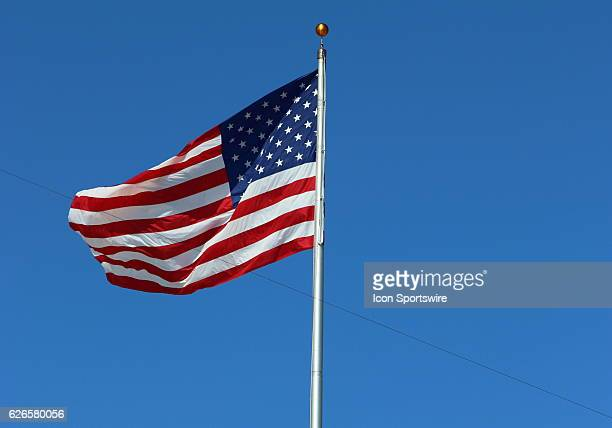 Flag flying on a beautiful day during pregame of the Lambeau Field College Classic at Lambeau Field in Green Bay WI
