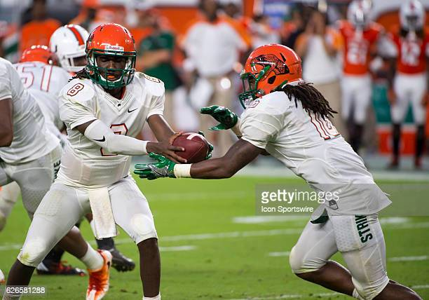 Florida A M Rattlers Quarterback Kenneth Coleman hands off the ball to Florida A M Rattlers Running Back Hans Supre during the NCAA football game...