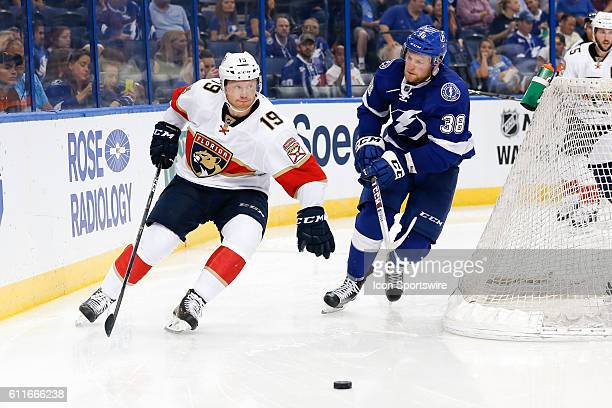 Florida Panthers defenseman Mike Matheson and Tampa Bay Lightning center Tanner Richard skate after the puck in the 3rd period of the Preseason NHL...