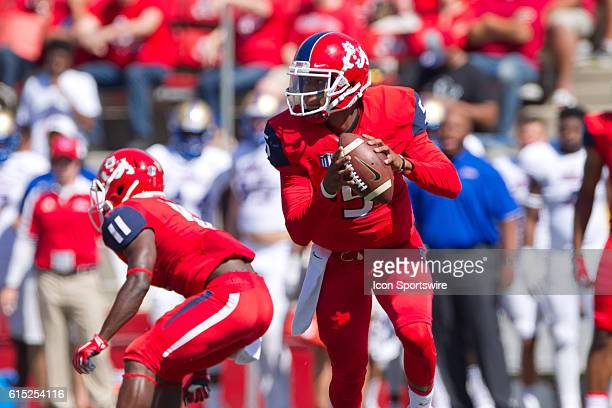 Fresno State Bulldogs quarterback Chason Virgil rolls out of the pocket during the game between the Fresno State Bulldogs and the Tulsa Golden...