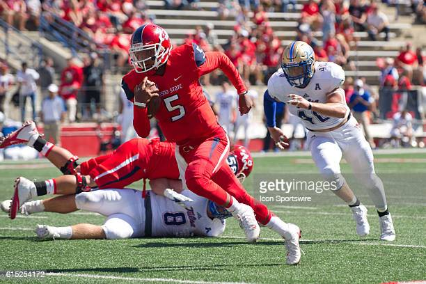 Fresno State Bulldogs quarterback Chason Virgil scores a touchdown during the game between the Fresno State Bulldogs and the Tulsa Golden Hurricane...
