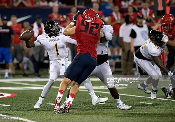 Grambling State Tigers quarterback DeVante Kincade drops back top pass during the NCAA football game between the Tigers and the Arizona Wildcats at...