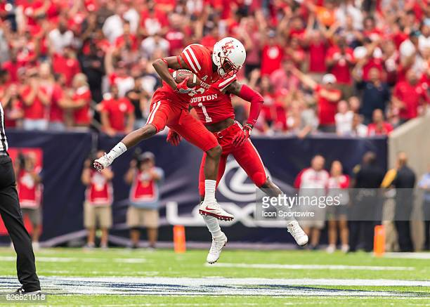 Houston Cougars cornerback Howard Wilson and Houston Cougars safety Garrett Davis celebrate after recovering a fumble during the AdvoCare Texas...