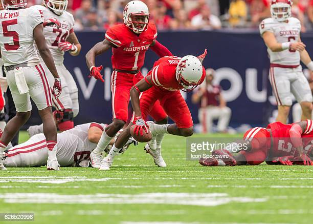 Houston Cougars cornerback Howard Wilson recovers the ball during the AdvoCare Texas Kickoff football game between the Oklahoma Sooners the Houston...