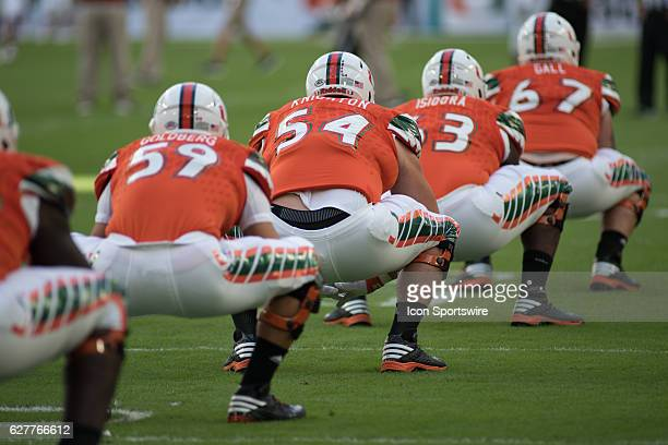 Miami Hurricanes Jared Hardie Hunter Knighton Danny Isidora and Alex Gall warm up prior to the NCAA football game between the Florida Atlantic Owls...