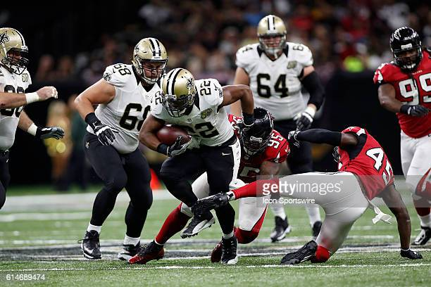 New Orleans Saints Running Back Mark Ingram is tackled by Atlanta Falcons Defensive Tackle Jonathan Babineaux at the MercedesBenz Superdome in New...