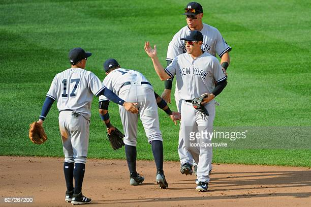 New York Yankees center fielder Jacoby Ellsbury followed by right fielder Aaron Judge are congratulated by shortstop Ronald Torreyes and second...