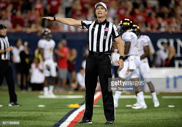 Referee Land Clark confirms a penalty flag during the NCAA football game between the Grambling State Tigers and the Arizona Wildcats at Arizona...