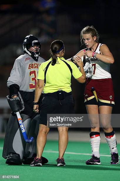 Referee Lynn Carrino talks to Boston College's Audra Hampsch and Frederique Haverhals . The Duke University Blue Devils hosted the Boston College...