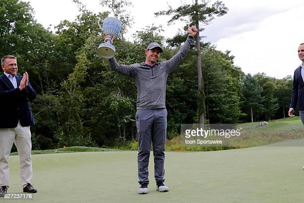 Rory McIlroy hoists the Wedgewood Trophy after winning the Deutsche Bank Championship at TPC Boston in Norton Massachusetts