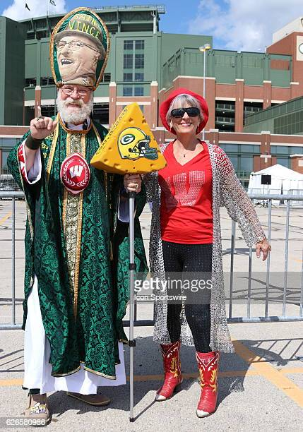 Saint Vince and Badger fan celebrating during pregame festivities at Lambeau Field in Green Bay WI