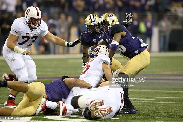 Stanford's Christian McCaffrey l gets wrapped up by Washington's Elijah Qualls #36 Azeem Victor and Keishawn Bierria Washington defeated Stanford 446...