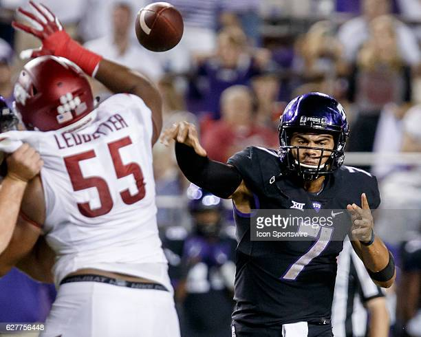 TCU Horned Frogs quarterback Kenny Hill throws a pass as defensive lineman Jeremiah Ledbetter applies the pressure during the college football game...