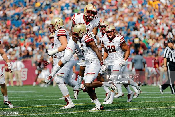 teammates mob Boston College defensive lineman Harold Landry after his interception The Boston College Eagles defeated the University of...