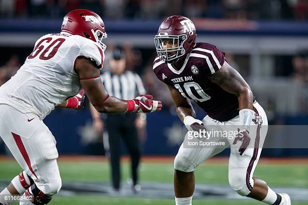 Texas AM Aggies defensive end Daeshon Hall and Arkansas Razorbacks tackle Brian Wallace during the Southwest Classic college football game between...