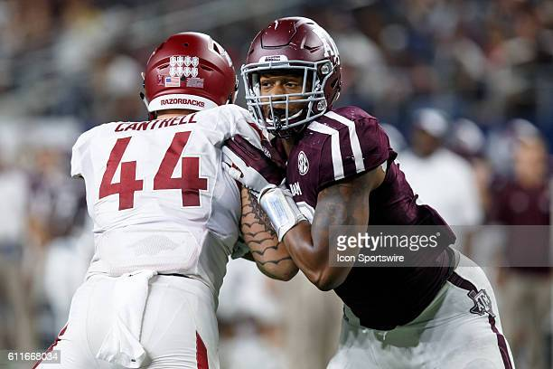 Texas AM Aggies defensive end Daeshon Hall and Arkansas Razorbacks tight end Austin Cantrell during the Southwest Classic college football game...