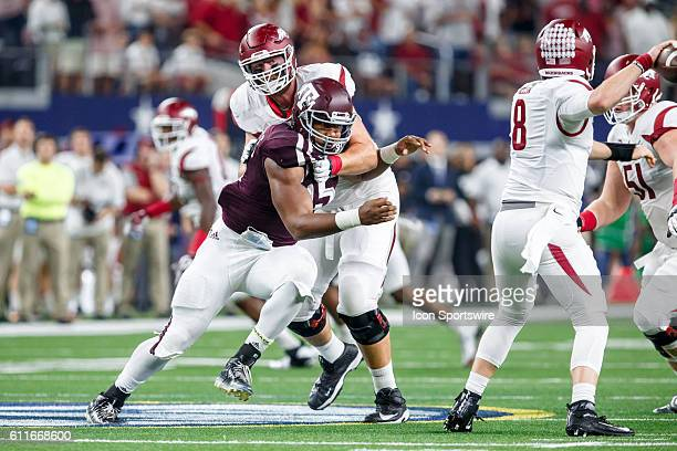 Texas AM Aggies defensive end Myles Garrett goes after the quarterback as Arkansas Razorbacks left tackle Dan Skipper tries to block during the...