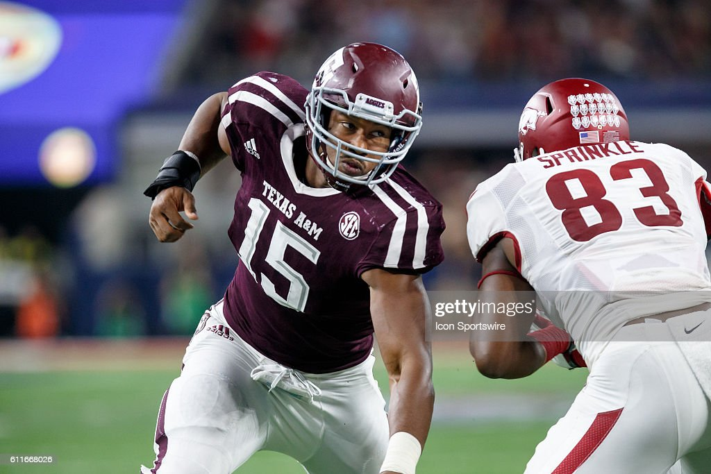 Texas A&M Aggies defensive end Myles Garrett (#15) works around Arkansas Razorbacks tight end Jermey Sprinkle (#83) during the Southwest Classic college football game between the Arkansas and Texas A&M at AT&T Stadium in Dallas, Texas. Texas A&M won the game 45-24.