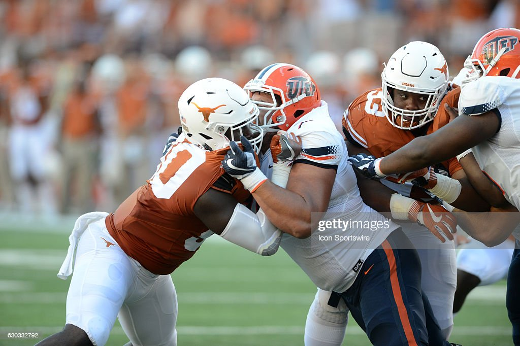 Texas DE Charles Omenihu (left) and Will Hernandez battle at the line of scrimmage as Paul Boyette (right) tries to sneak by during 41 - 7 win over UTEP at Darrell K. Royal - Texas Memorial Stadium in Austin, TX.