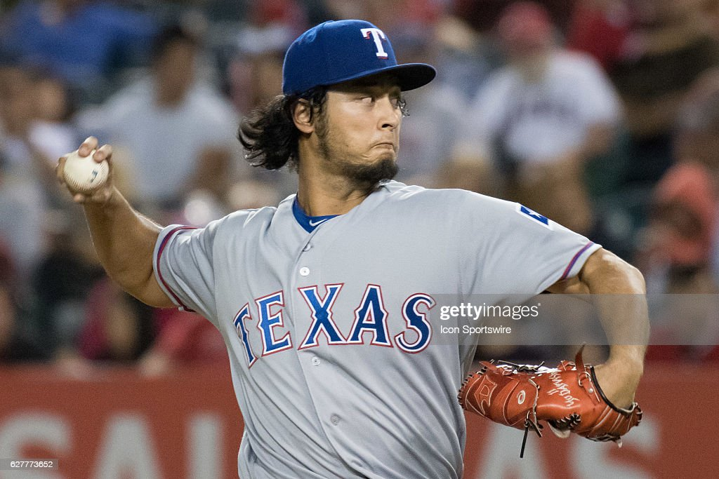 Texas Rangers Starting pitcher Yu Darvish (11) throws a pitch during the first inning during the game against the Los Angeles Angels of Anaheim played at Angel Stadium of Anaheim in Anaheim, CA.