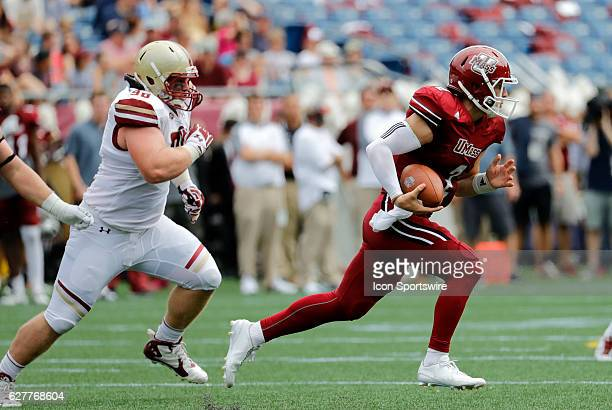 UMass quarterback Ross Comis chased from the pocket by Boston College defensive tackle Ray Smith The Boston College Eagles defeated the University of...