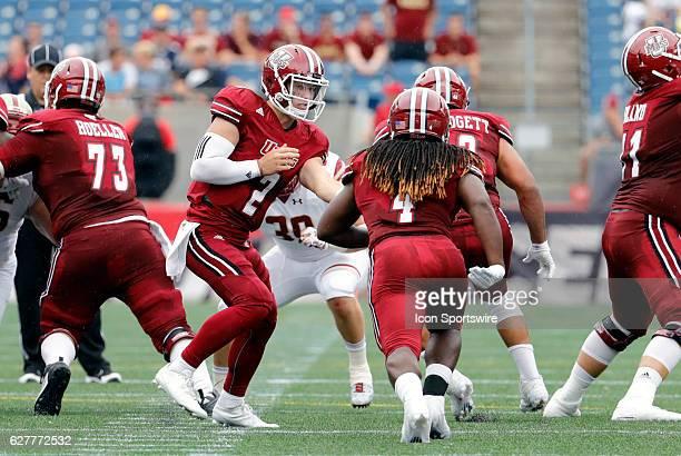UMass quarterback Ross Comis hands off to UMass running back Sekai Lindsay The Boston College Eagles defeated the University of Massachusetts...