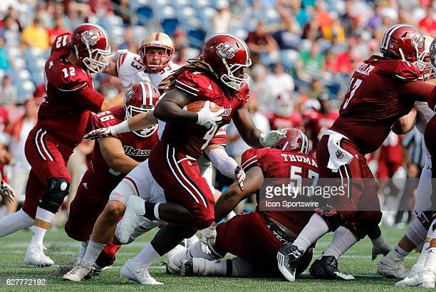 UMass running back Sekai Lindsay tries to geta round end The Boston College Eagles defeated the University of Massachusetts Minutemen 267 at Gillette...