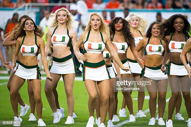 University of Miami cheerleaders perform on the field during the NCAA football game between the Florida A M Rattlers and the University of Miami...