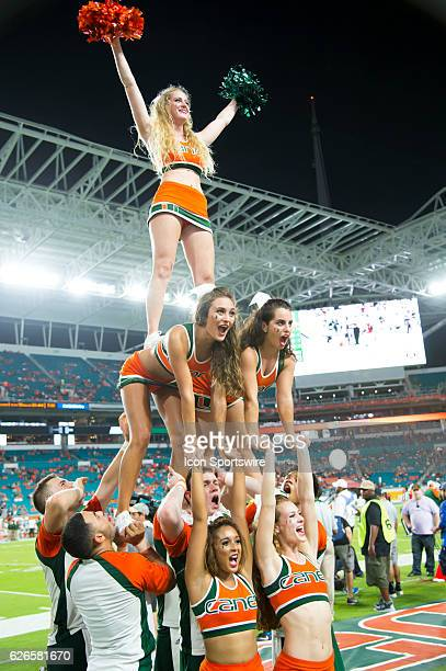 University of Miami Hurricane cheerleaders perform during the NCAA football game between the Florida A M Rattlers and the University of Miami...