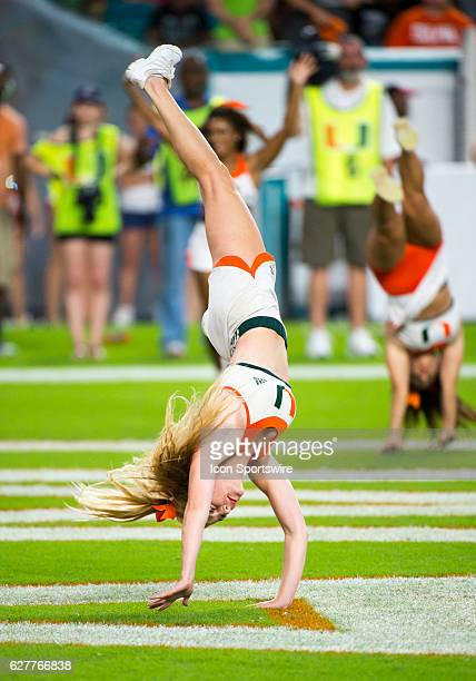 University of Miami Hurricanes cheerleaders perform during the NCAA football game between the Florida Atlantic Owls and the University of Miami...