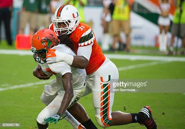 University of Miami Hurricanes Defensive Lineman Demetrius Jackson sacks Florida A M Rattlers Quarterback Kenneth Coleman during the NCAA football...