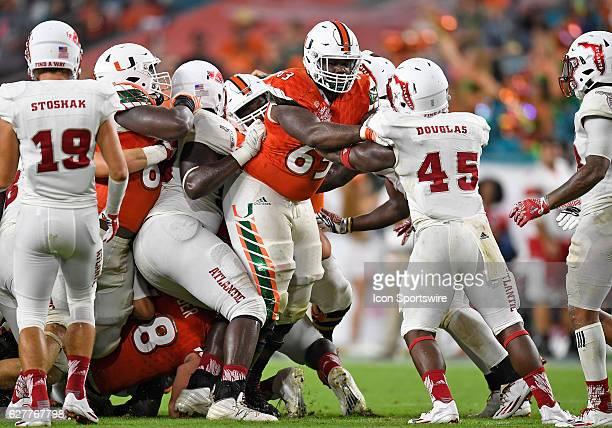 University of Miami offensive lineman Danny Isidora plays against Florida Atlantic University in Miami's 3810 victory at Hard Rock Stadium Miami...
