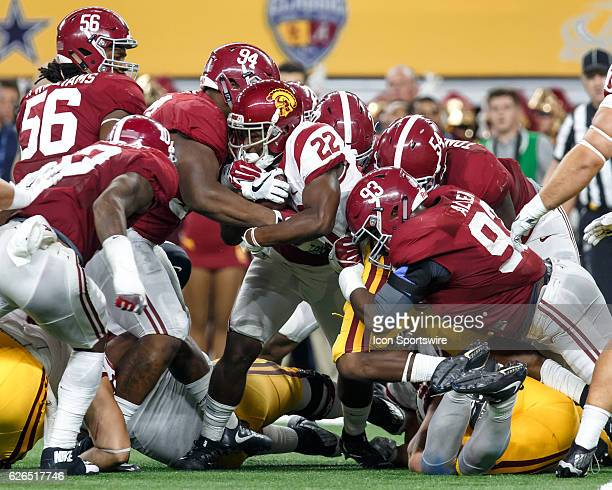 USC Trojans running back Justin Davis is tackled by Alabama Crimson Tide defenders including Jonathan Allen and Daron Payne during the Advocare...