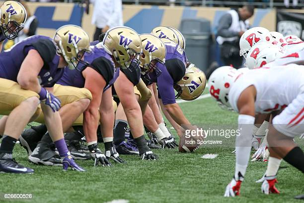 Washington players line up against Rutgers at the line of scrimmage Washington defeated Rutgers 4813 at Husky Stadium in Seattle WA