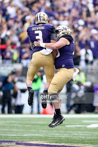 Washington's Jake Browning and Coleman Shelton celebrate after scoring a touchdown against Rutgers. Washington defeated Rutgers 48-13 at Husky...