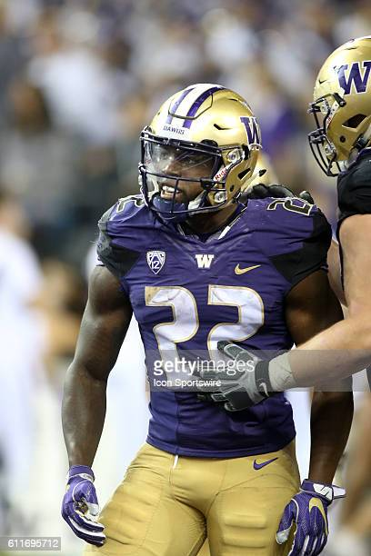 Washington's Lavon Coleman celebrates with teammates after scoring a fourth quarter touchdown Washington defeated Stanford 446 at Husky Stadium in...