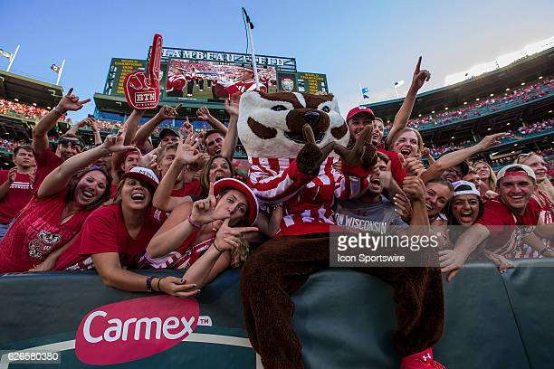 Wisconsin Badger mascot Bucky Badger does a Lambeau Leap to celebrate with fans after the Wisconsin Badgers defeat the 5th ranked LSU Tigers at the...
