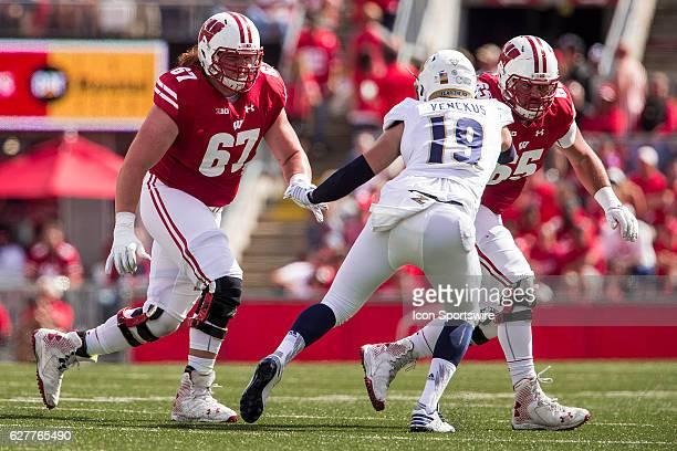 Wisconsin Badgers offensive lineman Jon Dietzen and Wisconsin Badgers offensive lineman Ryan Ramczyk look to block Akron Zips defensive end Daumantas...