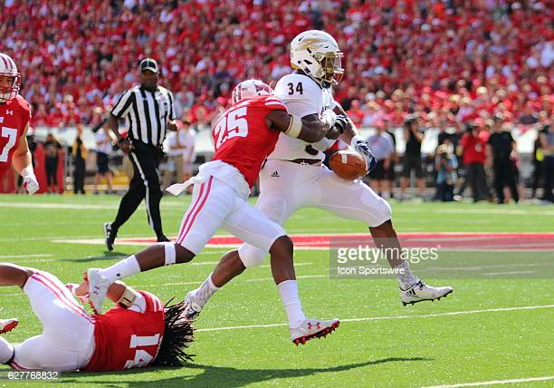 Wisconsin cornerback Derrick Tindal strips the ball from Akron running back Warren Ball during game action Wisconsin beat Akron by a final score of...