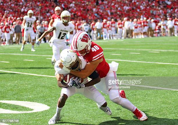 Wisconsin inside linebacker Jack Cichy tackles Akron wide receiver JoJo Natson Jr during game action Wisconsin beat Akron by a final score of 5410 at...